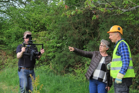 camera crew filming installation